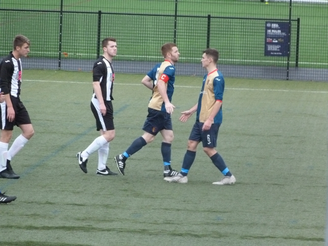Michael Anderson congratulates Craig Malcolm after scoring for Kilby