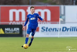 Tom, pictured playing for Cove Rangers.